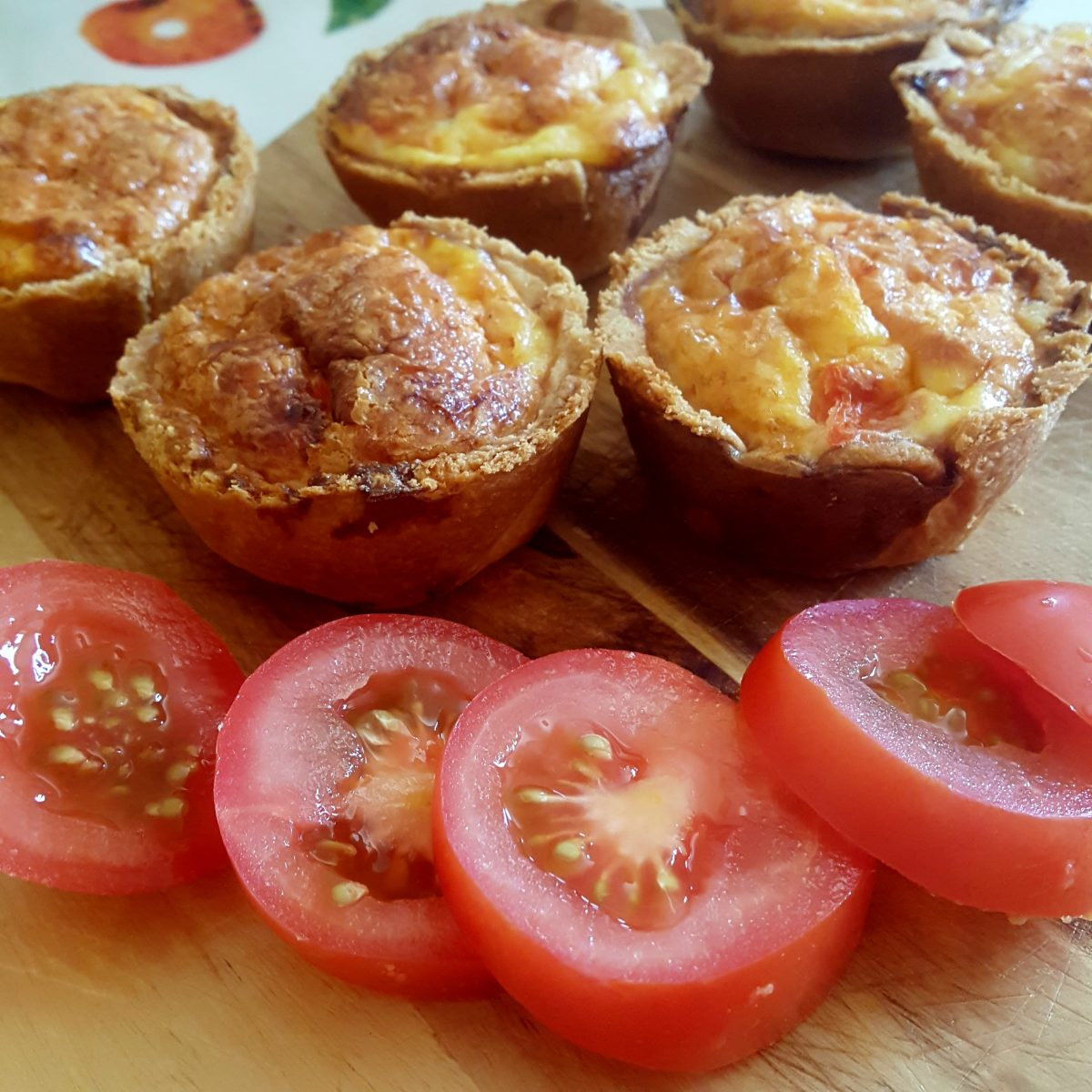 Mini cheese, ham and tomato quiches